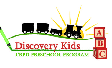 Discovery Kids Preschool Program logo sun on horizon with train crayon and building blocks