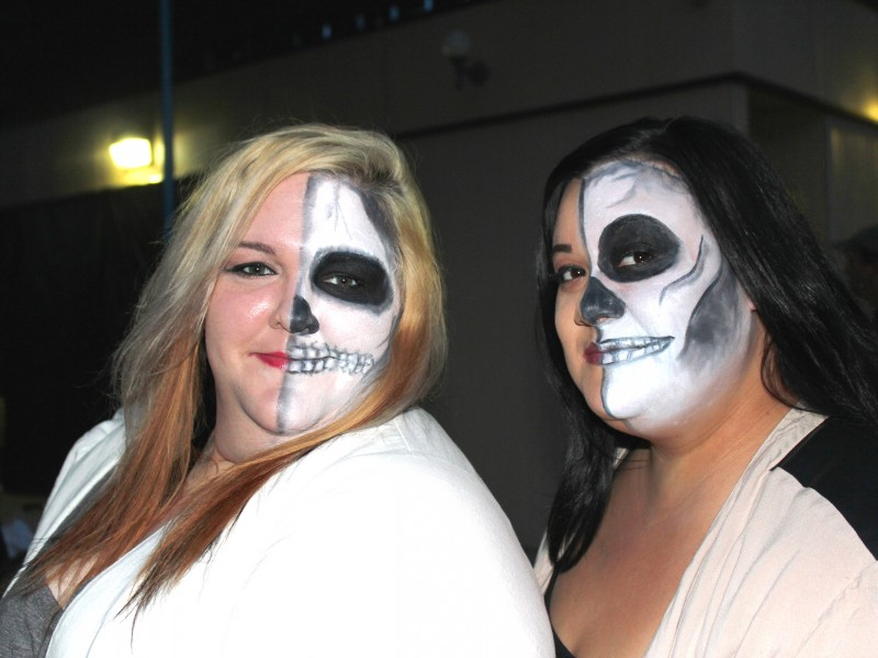 adults with skeleton face paint at halloween