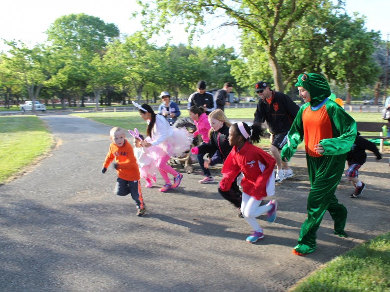 children and adults participating in a fun run