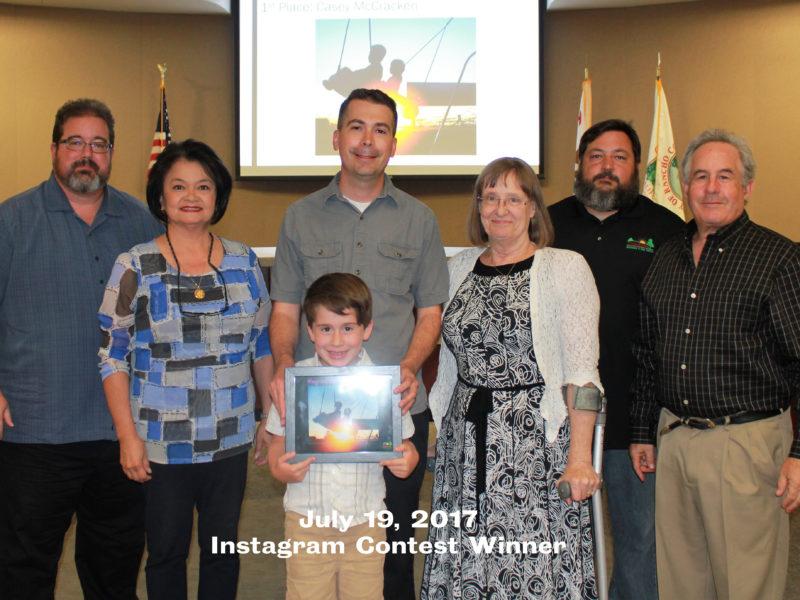 Board of Directors awarding certificate to Instagram Contest winner