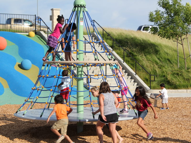 families playing at hillside park