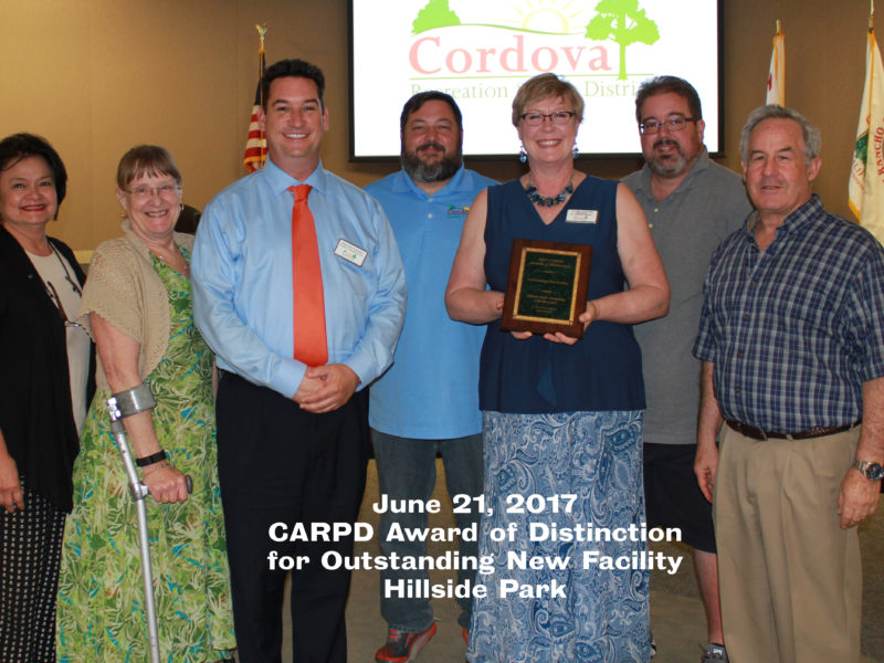 Board of Directors and staff accepting Outstanding New Facility award from CARPD