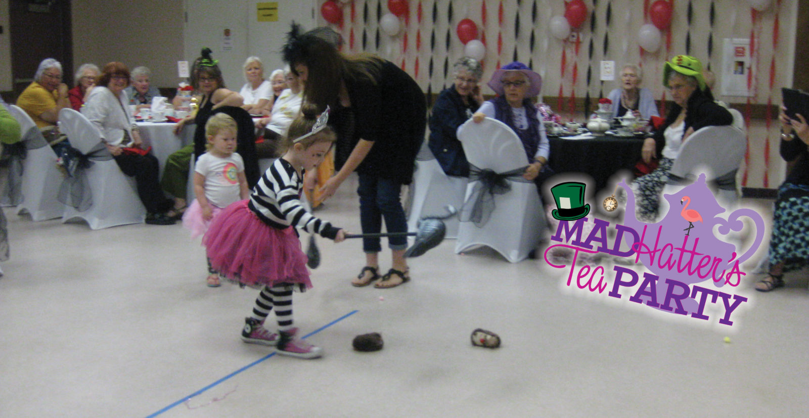 Mad Hatters Tea Party 2016 event kid playing flamingo croquet