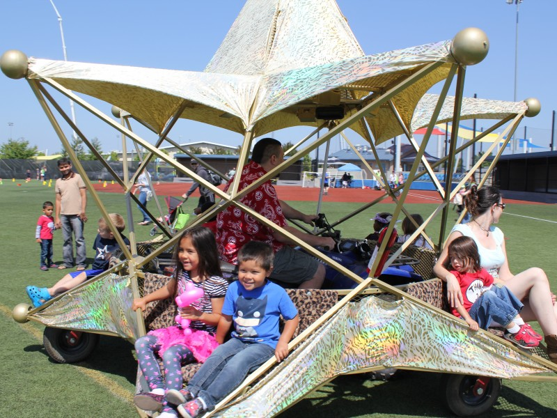 Children enjoying a star-shaped vehicle at meet the machines