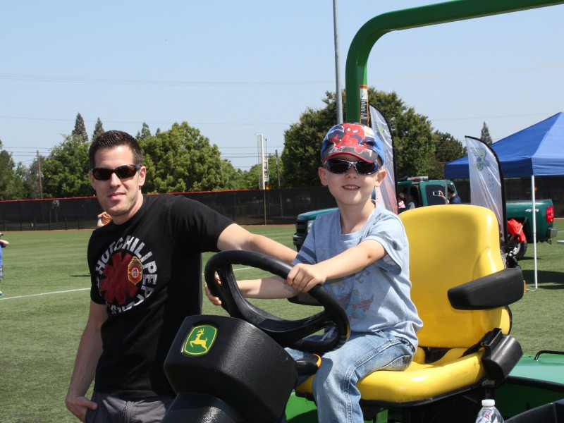 Child on a John Deere machine