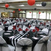 senior center multipurpose room set up with elegant red black and white decorations