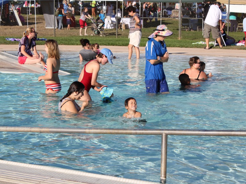 Children and adults enjoying Lincoln Pool at Party in the Park event