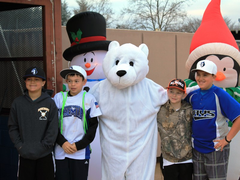 Children posing with the Polar Bear mascot