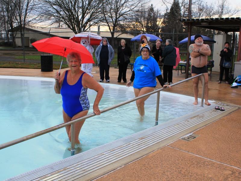 Adults entering pool at Polar Bear Plunge