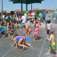 children playing in the spray park